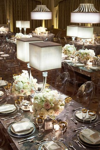 mirror-table-clear-ghost-chairs-white-blush-flower-centerpiece-lamp-and-grey-crocodile-leather-mat