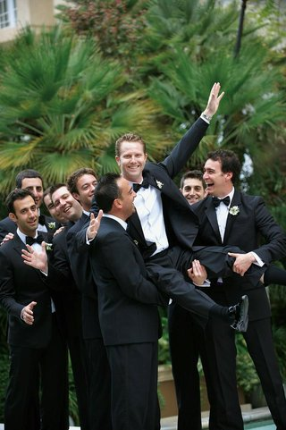 men-in-tuxedos-pick-up-the-groom-outside