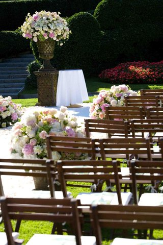 wood-chairs-with-neutral-toned-flower-arrangements