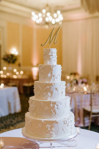 wedding-reception-ballroom-five-layer-wedding-cake-flower-vine-design-large-initial-cake-topper