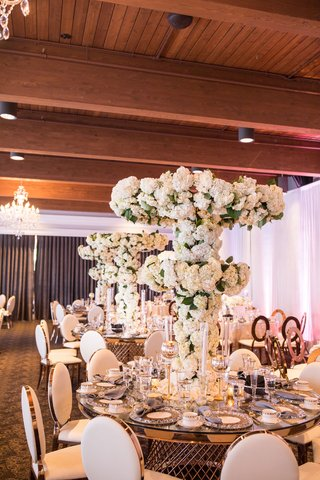 wedding-reception-gold-table-tall-centerpiece-tree-white-flowers-hydrangea-rose-orchid-flowers