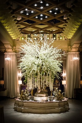 fountain-in-the-drake-hotel-with-a-large-arrangement-of-flowers-with-cascading-orchids