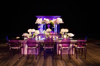 round-back-ghost-chairs-in-purple-at-head-reception-table