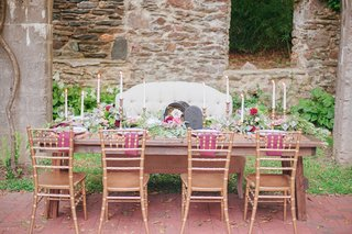 long-table-reception-rustic-wooden-tall-candles-purple-napkins-outdoor-celtic-wedding