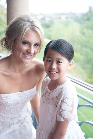 bride-in-strapless-oscar-de-la-renta-wedding-dress-updo-with-flower-girl-in-updo-and-white-dress