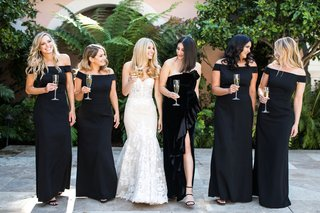 bride-in-strapless-inbal-dror-mermaid-wedding-dress-with-bridesmaids-black-dresses-off-shoulder-slit