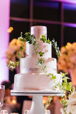 four-layer-white-wedding-cake-with-silver-leaf-details-monogram-green-vine-ivy-decor