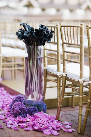 wedding-ceremony-gold-chairs-white-cushions-fuchsia-flower-petals-purple-calla-lilies-in-tall-vase