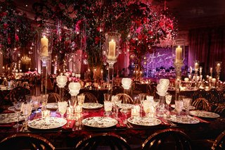 opulent-wedding-reception-ballroom-purple-neon-sign-red-lighting-decor-butterfly-china-candles
