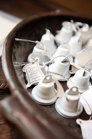 miniature-white-bell-wedding-favors-with-note-from-bride-and-groom