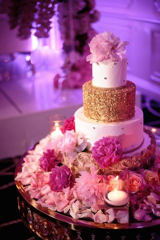 wedding-cake-with-gold-rosette-design-quilted-rhinestone-design-and-gold-tier-pink-peony-flowers