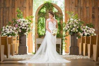 bride-in-pronovias-gown-with-illusion-neckline-lace-bodice-barn-wedding-ceremony