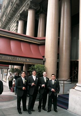 groomsmen-outside-westin-st-francis-with-cigars