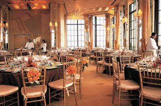 wedding-reception-ballroom-decorations-in-gold-orange-and-peach