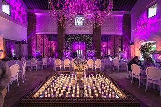 purple-pink-lighting-mirror-center-candles-destination-wedding-morocco-opulent-modern-traditional