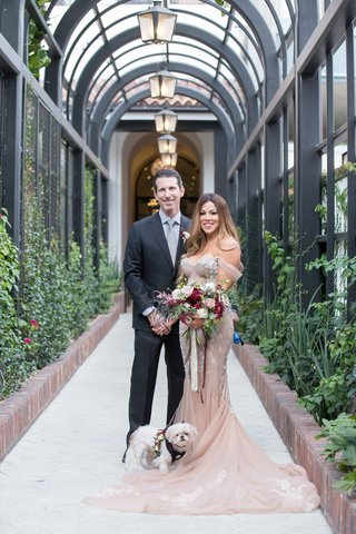bride-in-inbal-dror-wedding-dress-fall-bouquet-lilla-bello-with-groom-and-white-dog-with-flowers