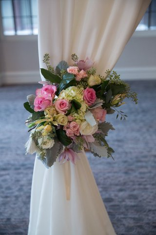 wedding-ceremony-draped-structure-tieback-of-roses-hydrangeas-orchids-in-blush-mint-pearl