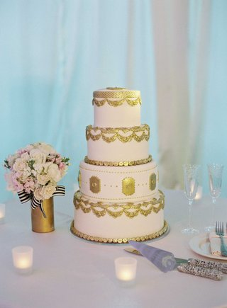 four-layer-light-pink-wedding-cake-with-gold-details-mini-reeses-peanut-butter-cups-and-sour-belts