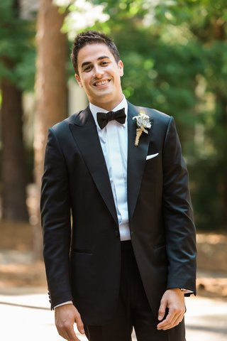 groom-in-tuxedo-with-bow-tie-and-rustic-succulent-wedding-boutonniere