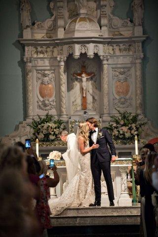 wedding-ceremony-at-catholic-church-in-santa-monica-california-marble-altar-ines-di-santo-dress
