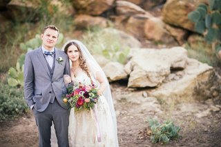 groom-in-grey-hugo-boss-three-piece-suit-with-bride-in-a-claire-pettibone-dress