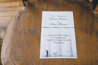 engagement-photo-wedding-invitation-for-skyline-loft-wedding-in-chicago-on-ceremony-chair