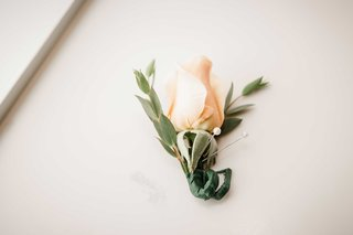 simple-salmon-colored-boutonniere-portland-oregon-pins-rustic-outdoor-wedding