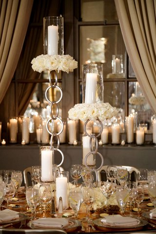wedding-reception-unique-modern-decor-rose-gold-mirror-table-with-chain-candleholder-pillar-candles