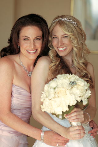 bride-with-maid-of-honor-and-wedding-bouquet