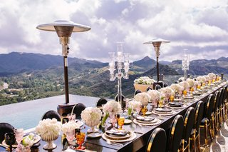 malibu-rocky-oaks-reception-long-black-table-with-black-and-gold-chairs-heat-lamps