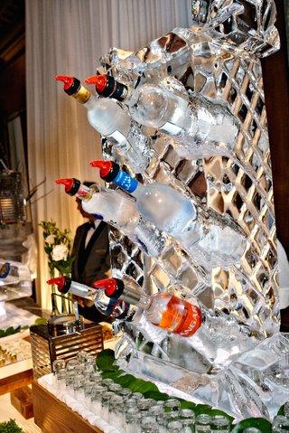 vodka-bottles-at-wedding-chilling-in-ice-sculpture