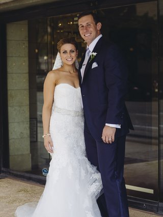 bride-in-lace-dress-with-football-player-groom