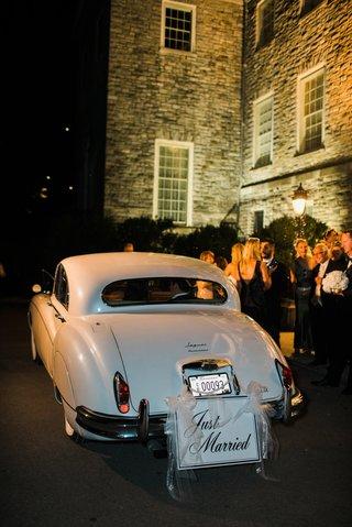 white-vintage-jaguar-getaway-car-with-just-married-sign
