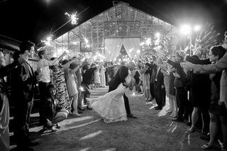 black-and-white-photo-of-bride-and-groom-at-santa-barbara-wedding-dip-sparkler-exit