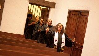 four-members-of-church-choir-sing