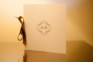 white-ceremony-program-with-gold-monogram