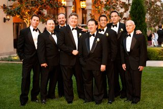 groom-and-his-seven-groomsmen-in-black-tuxedos