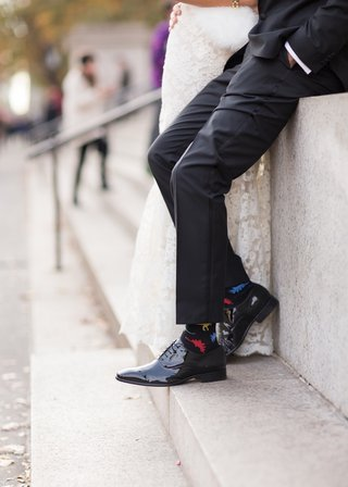 groom-wears-socks-covered-in-colorful-dinosaurs-with-his-black-tuxedo