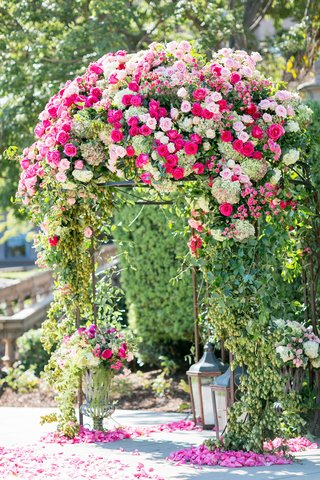 pink-rose-hot-pink-rose-greenery-on-domed-garden-pergola-arch-with-lanterns-and-urns-flower-petals