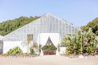 dos-pueblos-orchid-farm-in-santa-barbara-area-venue-greenhouse-white-drapery-landscaping-desert-chic