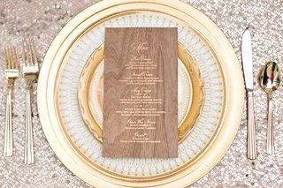 gold-plateware-wood-menu-charger-plates-silver-sequin-tablecloth-calligraphy-wedding-reception