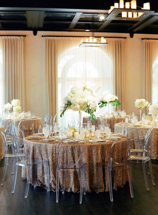 light-filled-ballroom-destination-wedding-gold-sequin-tables-tropical-centerpiece-ghost-chairs