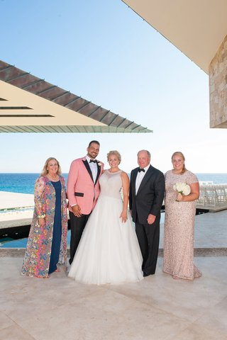 bride-in-mark-zunino-groom-in-salmon-suit-jacket-family-of-the-bride-portrait