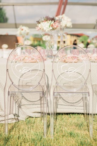 ghost-chairs-with-monogram-at-wedding-head-table