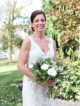 rustic-wedding-bouquet-with-lots-of-greenery-and-white-flowers