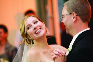 bride-in-silver-earrings-dancing-with-groom