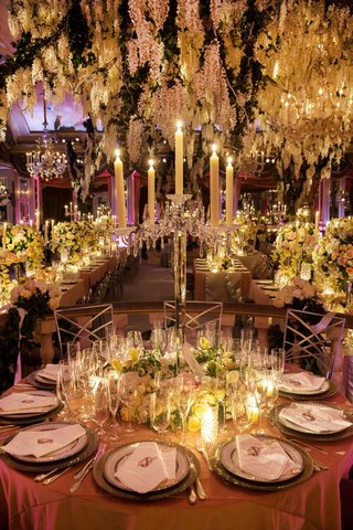flickering-taper-candles-atop-crystal-candelabra