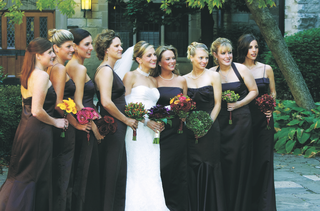 bridesmaids-in-long-mismatched-dresses-carrying-bouquets-in-different-fall-colors