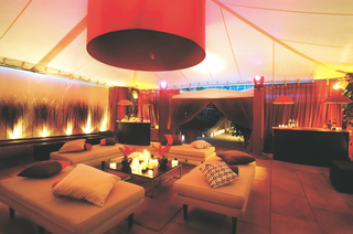 tented-reception-lounge-area-with-cushioned-benches
