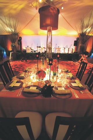 tented-reception-area-with-modern-fabric-wrapped-chandeliers-and-dance-floor-with-leaf-projections